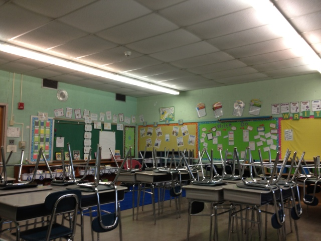 my classroom when I first set it up, chairs on the desks, nothing had been touched